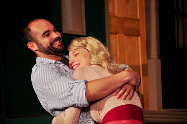 Photo of actors hugging